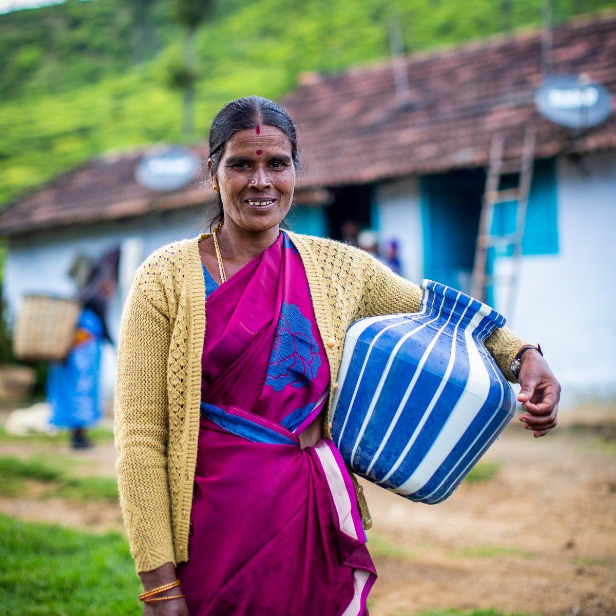 Sannamma tea plucker carrying water